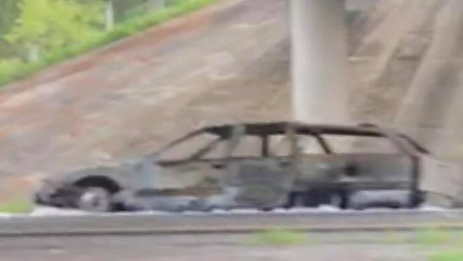 A passerby on I-10 captured this photo of the charred vehicle. The fiery crash snarled traffic for miles on I-10 Sunday.