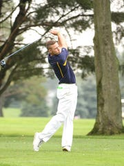 Woodmore's Mitchell Miller drives on the 18th hole in the NBC Championship at Green Hills