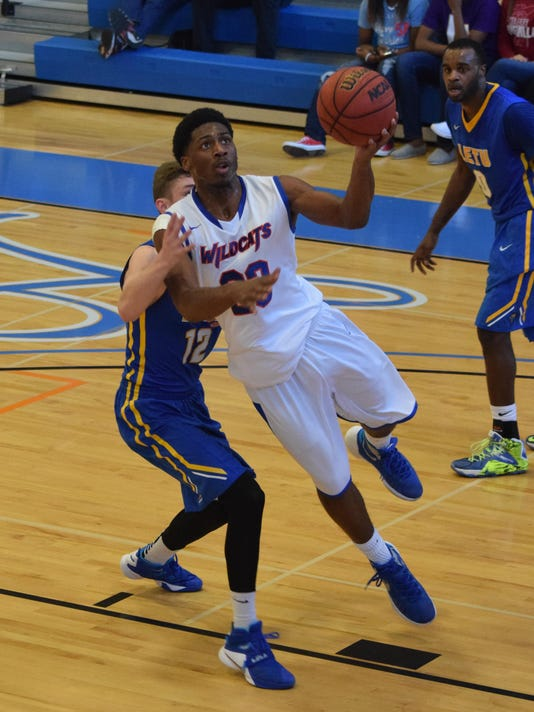 Louisiana College's Steve Evans (23, front) shoots against LeTourneau's C.J. Bird (20, back) Saturday.