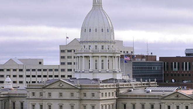 The state Capitol and other buildings in downtown Lansing are seen in this September 2014 LSJ file photo.