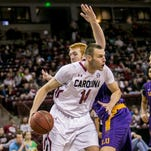 Nov 27, 2015; Columbia, SC, USA; South Carolina Gamecocks forward Laimonas Chatkevicius (14) drives around Lipscomb Bisons center David Wishon (33) in the first half at Colonial Life Arena. Mandatory Credit: Jeff Blake-USA TODAY Sports