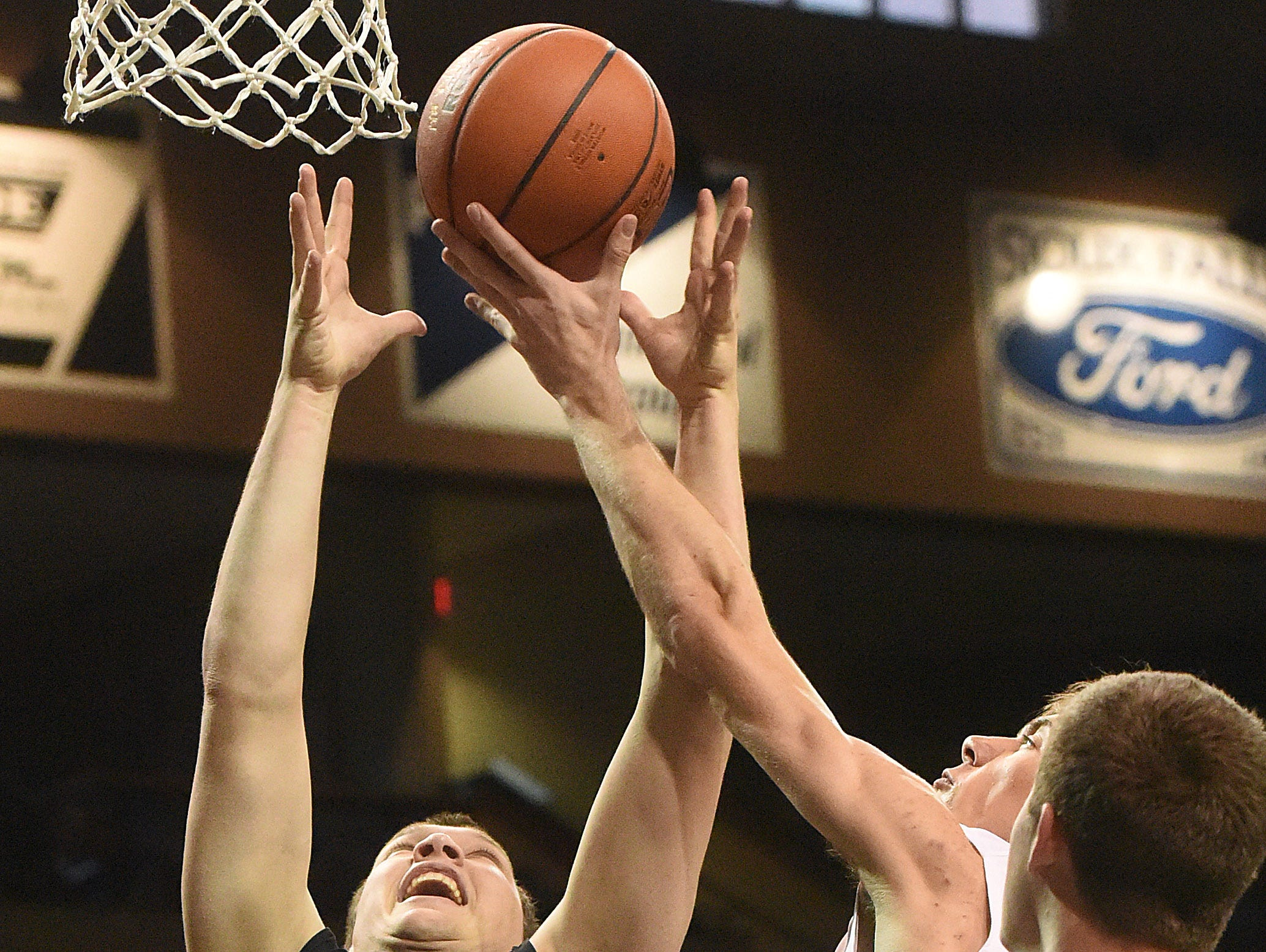 The Blue Team's Jacob Hinker (15) goes up for a shot while the White Team's Ethan Kranhold rebounds the ball during the Argus Leader/Sanford Pentagon First Five All-Star Game on Sunday, April 10, 2016, at the Sanford Pentagon in Sioux Falls.
