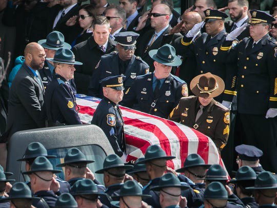 The body of Wilmington Police Capt. Stephen Misetic leaves the Chase Center on the Riverfront after the completion of the memorial service.