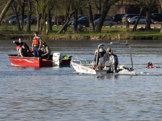 St. Cloud Fire Department firefighters and Stearns County Sheriffs deputies search the Mississippi River Monday, May 7, for a possible downing victim.