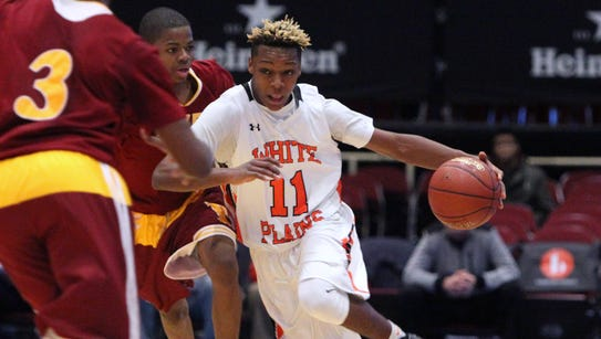 White Plains' Miles Hardy drives on Cardinal Hayes'