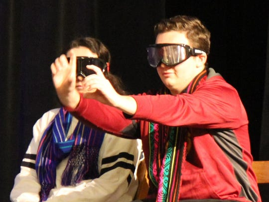 St. Elizabeth senior Rob Miller wears visual impairment goggles to simulate driving under the influence.