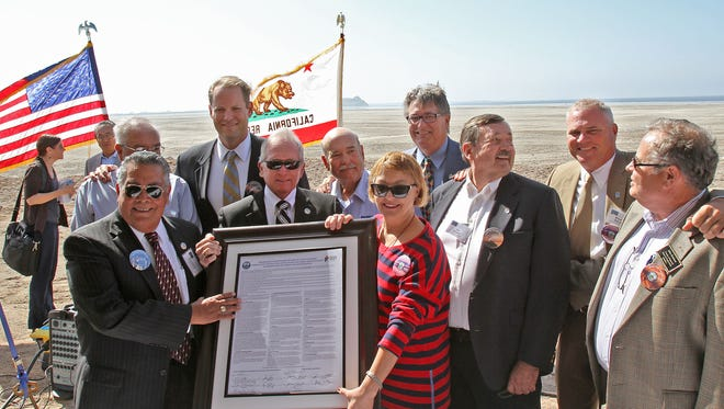 Members of the Imperial Irrigation District board of directors and the Imperial County board of supervisors commemorate the signing of a Salton Sea agreement at Red Hill Marina on Oct. 24, 2013. Left to right: Ray Castillo, Stephen Benson, Michael Kelley, Bruce Kuhn, Norma Sierra Galindo, Matt Dessert, Jim Hanks, Ryan Kelley and John Renison.