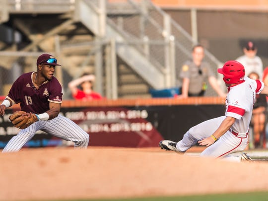 UL's Zach LaFleur slides safely into third base as the Cajuns play Texas State in game two of a three-game series Saturday May 13, 2017.