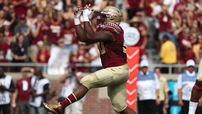FSU's Demarcus Christmas celebrates a sack against Miami during their game at Doak Campbell Stadium on Saturday, Oct. 7, 2017.