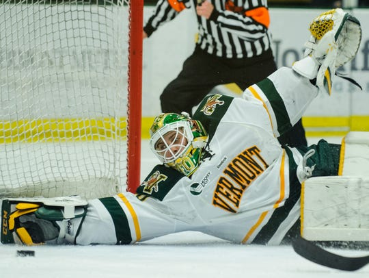Vermont goalie Stefanos Lekkas (40) makes a diving