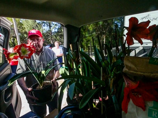 Waylon puts the last plant into the back of the truck. Waylon and Barbara Snead have spent the entire month of March at Sanibel's Periwinkle Park campground for the past 19 years. They departed with their travel trailer Friday morning, for their home in Raleigh North Carolina. They spent Friday morning packing up the last few things into the back of their pickup truck and trailer for the four-day journey. They will stop and visit friends and family along the way home. Shot on April 1, 2016.