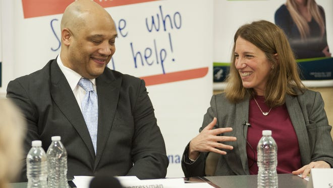 Congressman AndreŽ Carson and Secretary of Health and Human Services Sylvia Burwell discuss the Affordable Care Act at the United Way in Indianapolis.