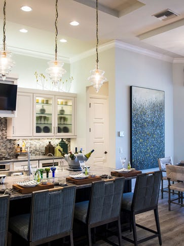 The kitchen and dining area of the Aviano, a three-bedroom,