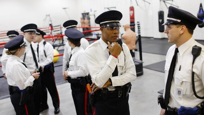 Columbus Police recruit Aaron Pollard, center, speaks with his scenario partner Eric Ratliff, right, before a training exercise on Thursday, Feb. 8, 2018 at the Columbus Police Training Academy.