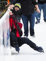 Tanner (top), 7, and Aiden Smith, 11, get help from