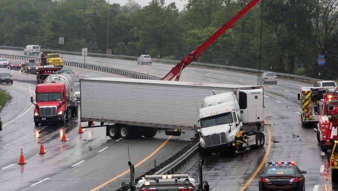 A tractor-trailer accident on I-287 near Exit 9 in Harrison backed up traffic in both directions for miles June 13, 2014. The truck which was traveling west jumped the center guardrail into the eastbound lanes. The truck's saddle tanks ruptured spilling diesel fuel onto the highway and nearby storm drains. The Westchester County Haz-Mat Team was called to the scene.