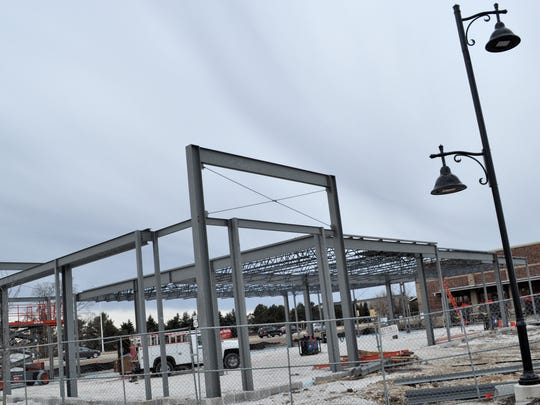 Construction began in February on a 8,329-square-foot, multi-tenant building near Brennan's Marketplace in Pabst Farms.