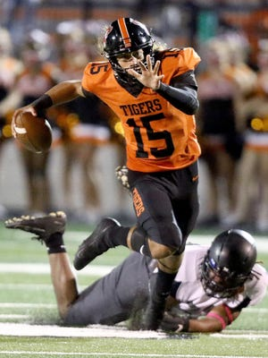 Massillon sophomore quarterback Jayvian Crable (15) eludes the grasp of a defender during the Tigers' Week 2 win over Columbus Bishop Sycamore on Friday September 4th 2020.