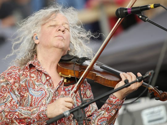 Tim Carbone of Railroad Earth plays the violin during a song at the McDowell Mountain Music Festival on March 5, 2017 in Phoenix, Ariz.