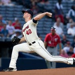 Atlanta Braves starting pitcher Alex Wood (40) works in the first inning of a baseball game against the Washington Nationals  Sunday, Aug. 10, 2014 in Atlanta. (AP Photo/John Bazemore)