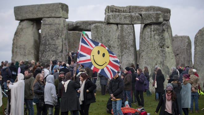 Druids, pagans and revellers gather Dec. 21, 2016, at Stonehenge, hoping to see the sun rise as they take part in a winter solstice ceremony at the ancient neolithic monument of Stonehenge near Amesbury in Wiltshire, England.