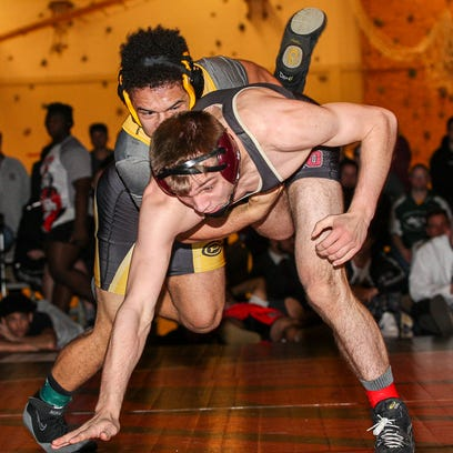Piscataway's MIchael Petite, top, wrestles Hillsborough's