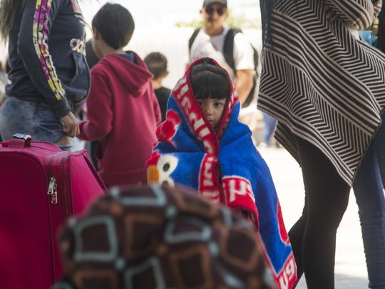 Central American migrant children wait near The El