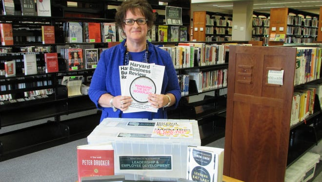 Somerset County Library System of New Jersey now has a new collection available for checkout geared toward small business professionals: SCLSNJ Business Kits.  Pictured with the kit is Cathy DeBerry, adult services and business librarian.