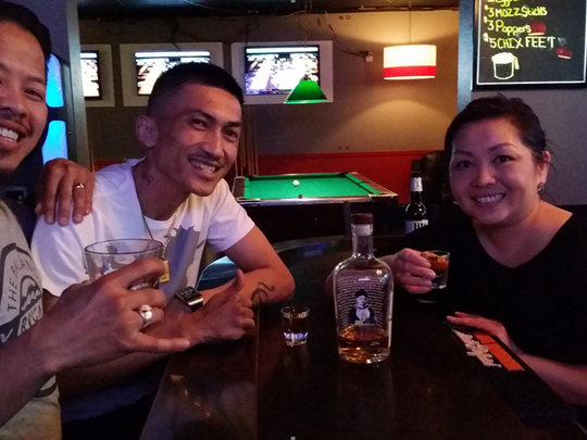 Christine Vang (right) enjoys a drink with friends at her Oshkosh bar. A Wausau version of the bar, named Christine's, will open this summer on Third Avenue.