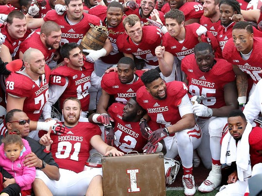 The Indiana Hoosiers celebrate winning the Oaken Bucket over Purdue. Indiana University defeated Purdue University in the Old Oaken Bucket game Satuday, November 29, 2014, at Memorial Stadium in Bloomington IN.