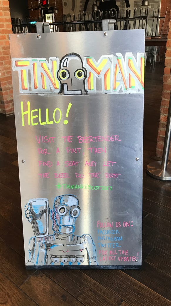 The board at Tin Man greets you with the new procedure.