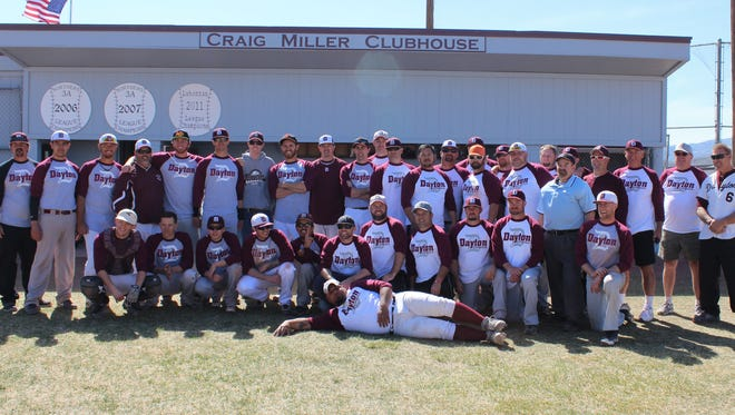 The two teams, with 27 former players and several former coaches pose for a picture after the Dayton High School alumni baseball game last Saturday.