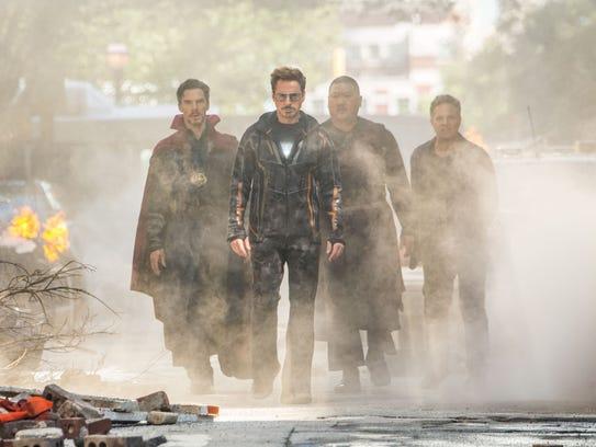 Tony Stark (Robert Downey Jr., front) heads up a crew