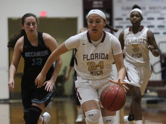 Florida High's Jordan Rosier leads a fastbreak during a Region 1-5A quarterfinal win over North Bay Haven.