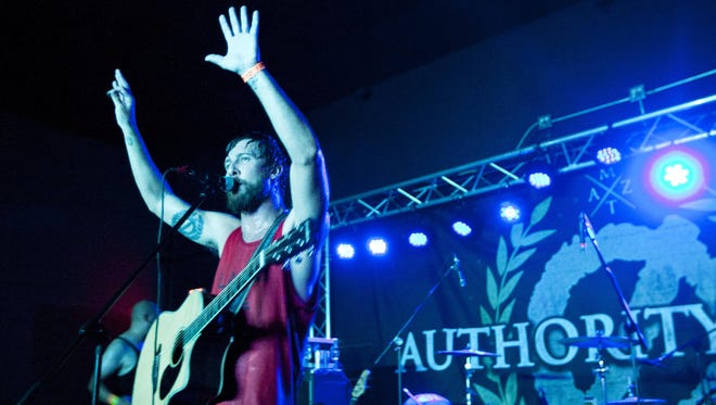 Jason DeVore of Authority Zero rocks the Club Red stage back on March 31, 2014.