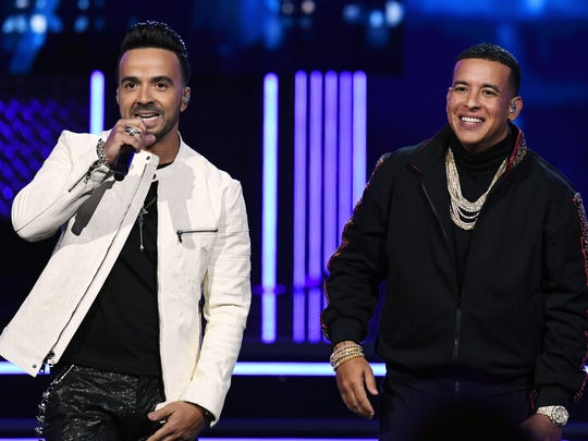 Luis Fonsi (L) and Daddy Yankee (R) perform onstage during the 60th Annual GRAMMY Awards at Madison Square Garden on January 28, 2018 in New York City.