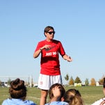 Olympic gold medalist Abby Wambach teaches teens how to do headers during last year's Get Fit Great Falls' Elite Soccer Camp.