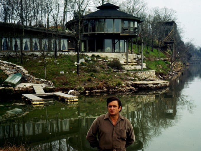 """Johnny Cash is at his """"nature house"""" on Old Hickory Lake near Hendersonville, Tenn. Cash was having a few beers with architect Braxton Dixon at the site and Cash asked """"What in the world is that?"""" Dixon, who built the house for himself, answered """"It's mine."""" Cash said, """"No, it's mine!"""""""