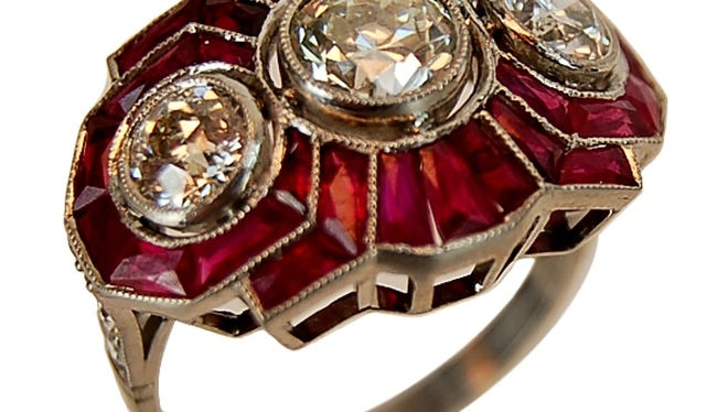 This antique platinum, diamond and ruby Art Deco ring sold for $4,750 at auction in 2014.