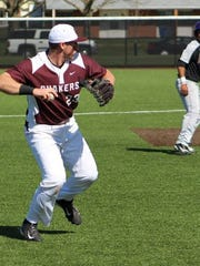 Earlham's Brandon Smalling prepares to throw to first base on a ground ball.