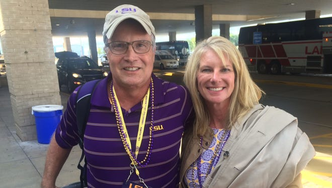 LSU fans Leeland and Tracie Kilpatrick arrived Thursday at Green Bay Austin Straubel International Airport in Ashwaubenon on a chartered flight from Baton Rouge, La. The Kilpatricks' home was destroyed by flooding last month.