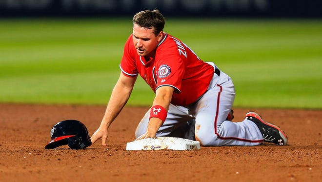Washington Nationals third baseman Ryan Zimmerman reacts to being picked off in the fifth inning against the Atlanta Braves at Turner Field.
