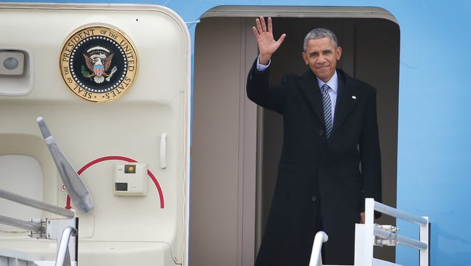 President Obama waves as he arrives in Indianapolis on Air Force One. Obama traveled to Indianapolis to speak at Ivy Tech Friday, February 6, 2015.