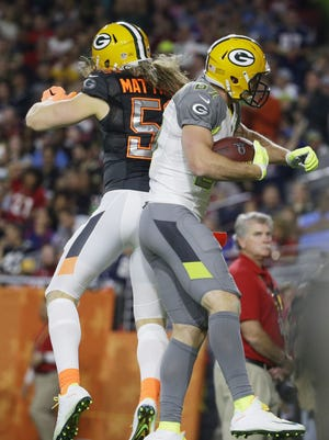 Green Bay Packers' Jordy Nelson celebrates with Green Bay Packers' Clay Matthews after scoring a touchdown during the first half of the NFL Football Pro Bowl Sunday, Jan. 25, 2015, in Glendale, Ariz. (AP Photo/Charlie Riedel)