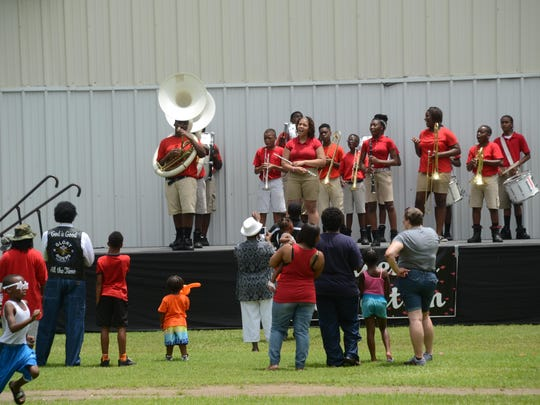 The Arthur F. Smith Middle Magnet School Band performs at the Children's Fun in the Park at Frank O. Hunter Park which was part of the Juneteenth celebrations held Saturday.