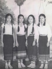 Mina Khamphilavong, far left, and her classmates are photographed before the fall of Laos to the Communists.