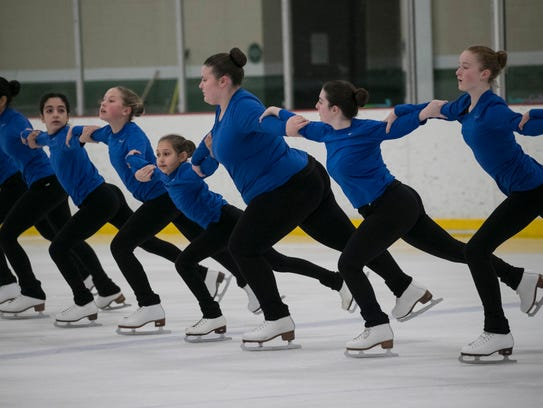 Members of the Shimmers Synchronized Skating Team from