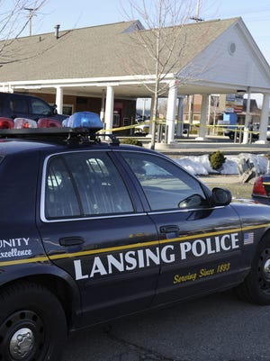 Lansing Police on the scene as State Police investigate a fatal shooting at a Bank of America branch on Martin Luther King Jr. Blvd in Lansing Monday morning  3/14/2011.