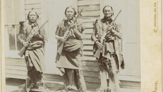 """This cabinet card, which will be shown during Jeffrey Richardson's """"Repeating Firearms on the American Frontier"""" lecture this weekend, features Comanche police holding their Winchester rifles."""