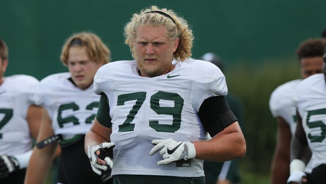 Michign State offensive lineman Kodi Kieler goes through practice in East Lansing on Monday, Aug. 22, 2016.
